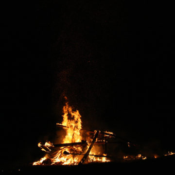 "image of structure from Burning Man burning in ""alchemy"" festival"