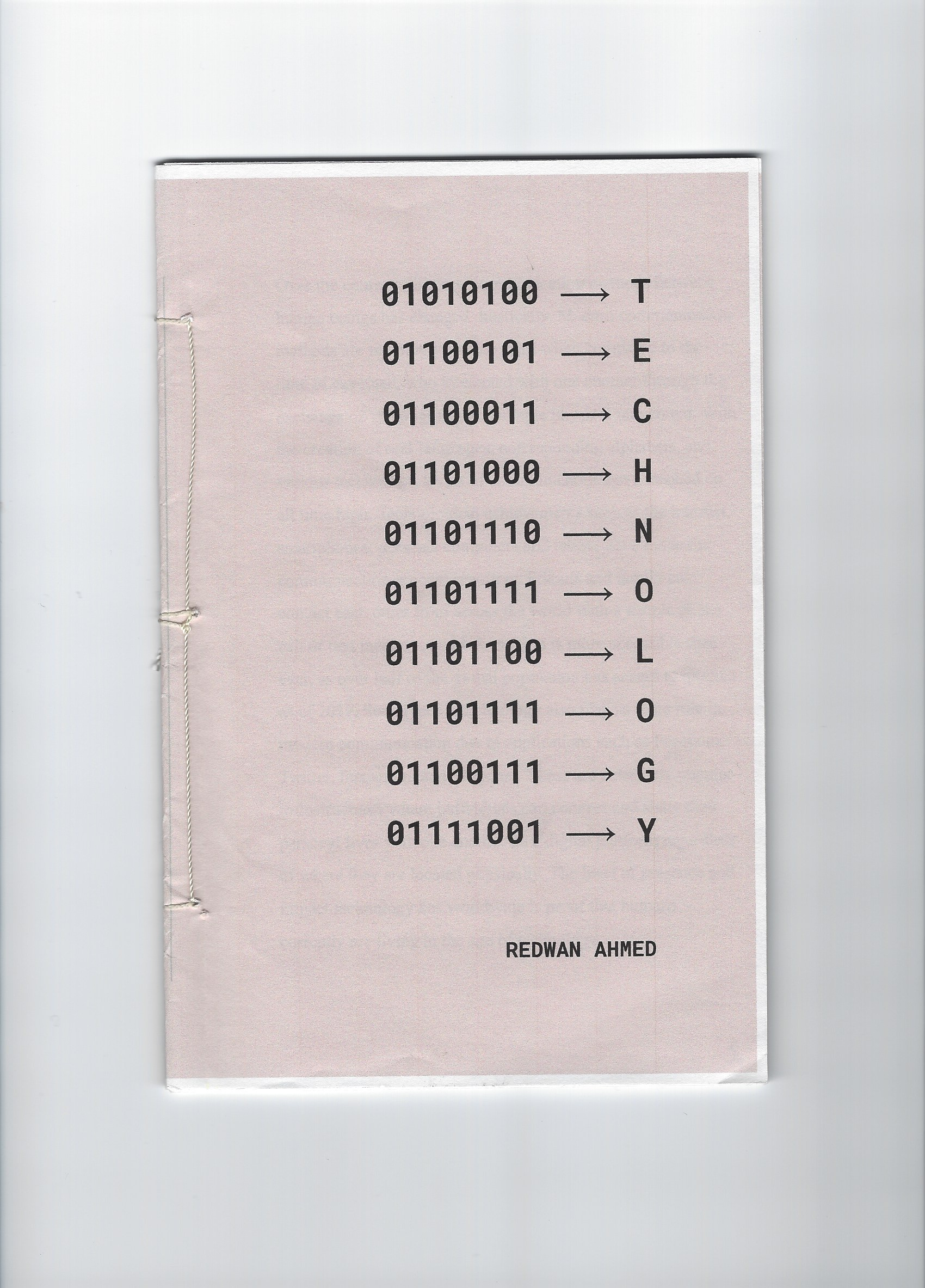 Front Cover: The front cover page that displays the title of the work in both binary code and english. The authors name is presented towards the bottom of the page.