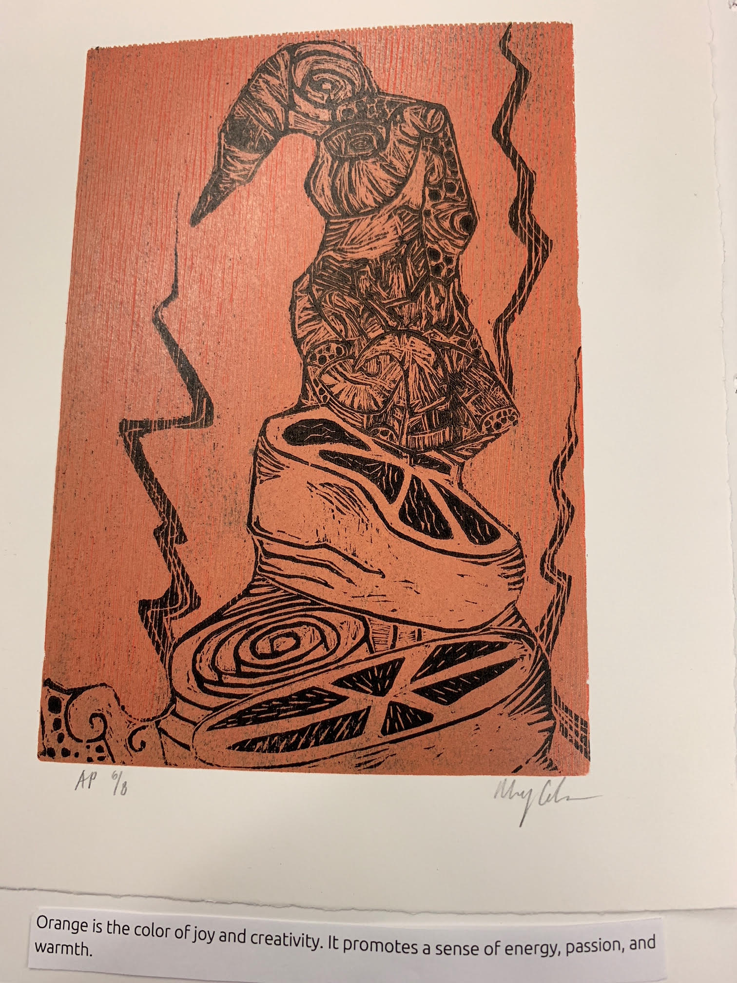 Page 10. Caption: Center of the page is an abstract print that is orange with a red background. Orange is the color of joy and creativity; it promotes a sense of energy, passion, and warmth.