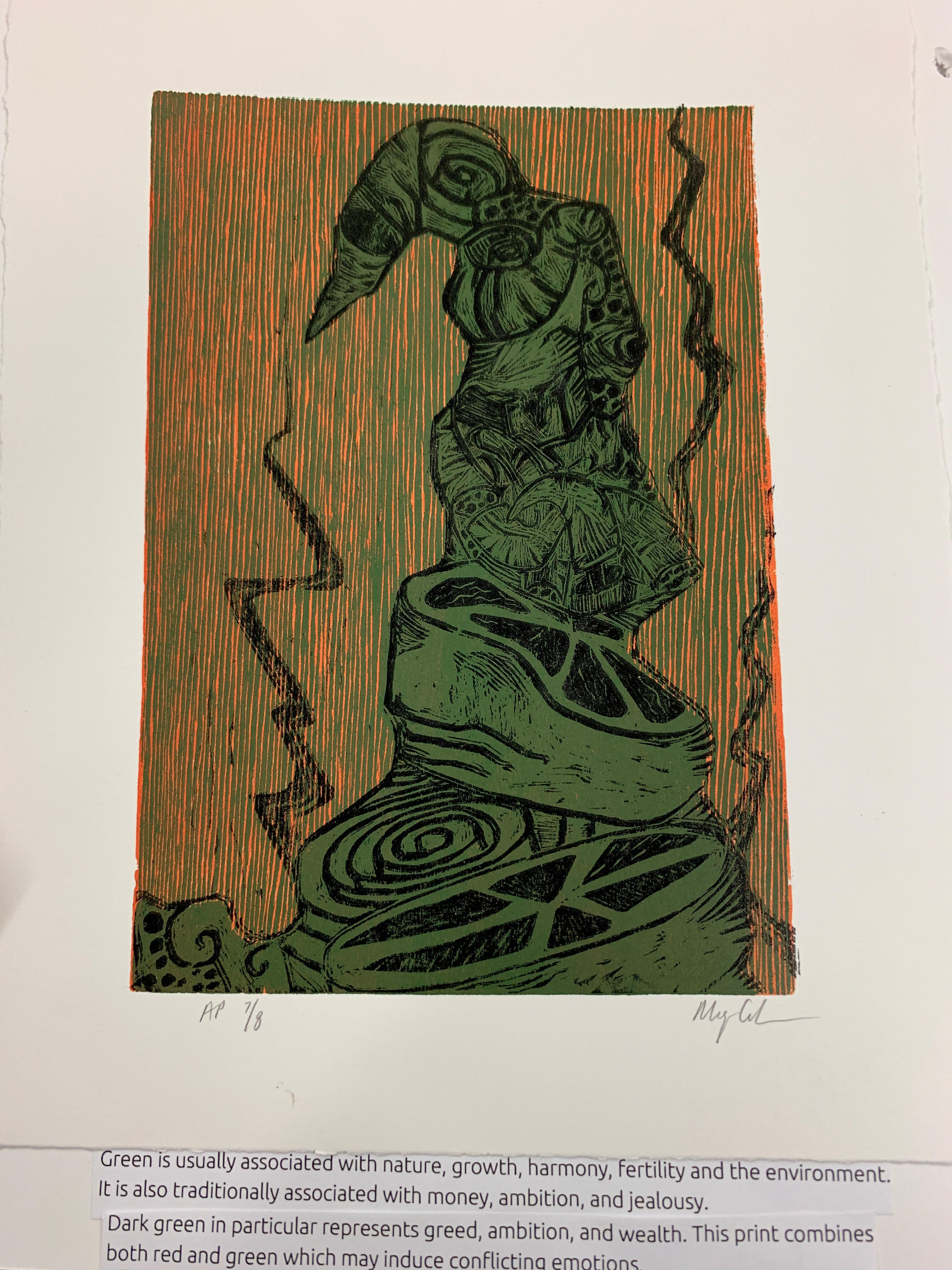 Page 5. Caption: In American society, green is typically associated with nature, growth, harmony, fertility, and the environment. It also signifies money, ambition and jealousy. The dark green presented in this abstract print is associated with greed, wealth, and ambition. The background usage of red with the predominant dark green may cause a calming and warming affect.