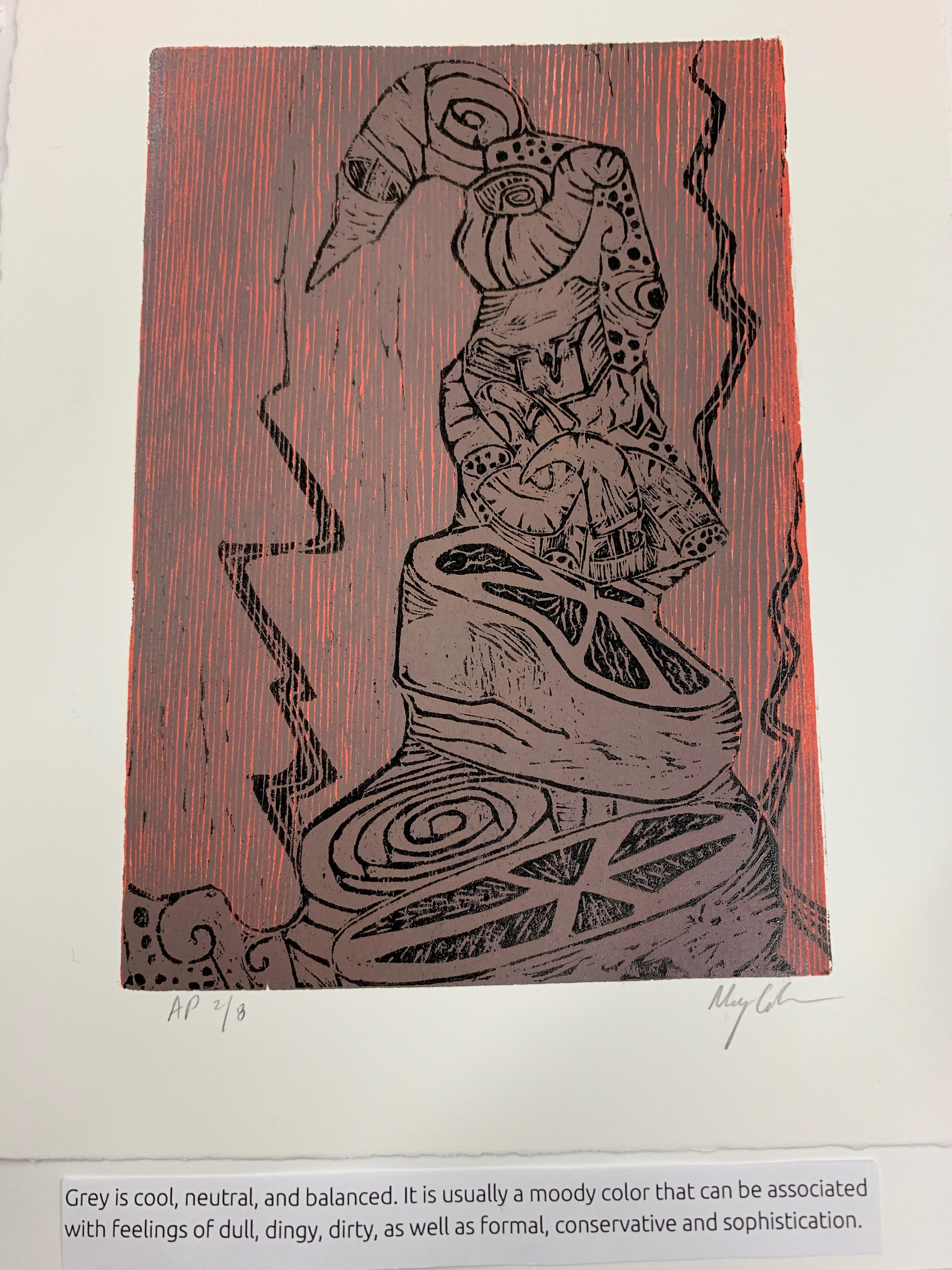 Page 9. Caption: The abstract print is predominantly grey, with a red background. Grey is cool, neutral, and balanced. It is usually a moody color that can be associated with feelings of dullness, dinginess, dirtiness, as well as formality, being conservative and/ or sophistication.