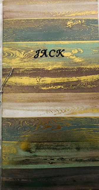 "The pages of my chapbook are made from cardboard/construction like paper purchased from the craft store Michaels. The front cover includes the title ""Jack"", placed on a metallic like design paper."