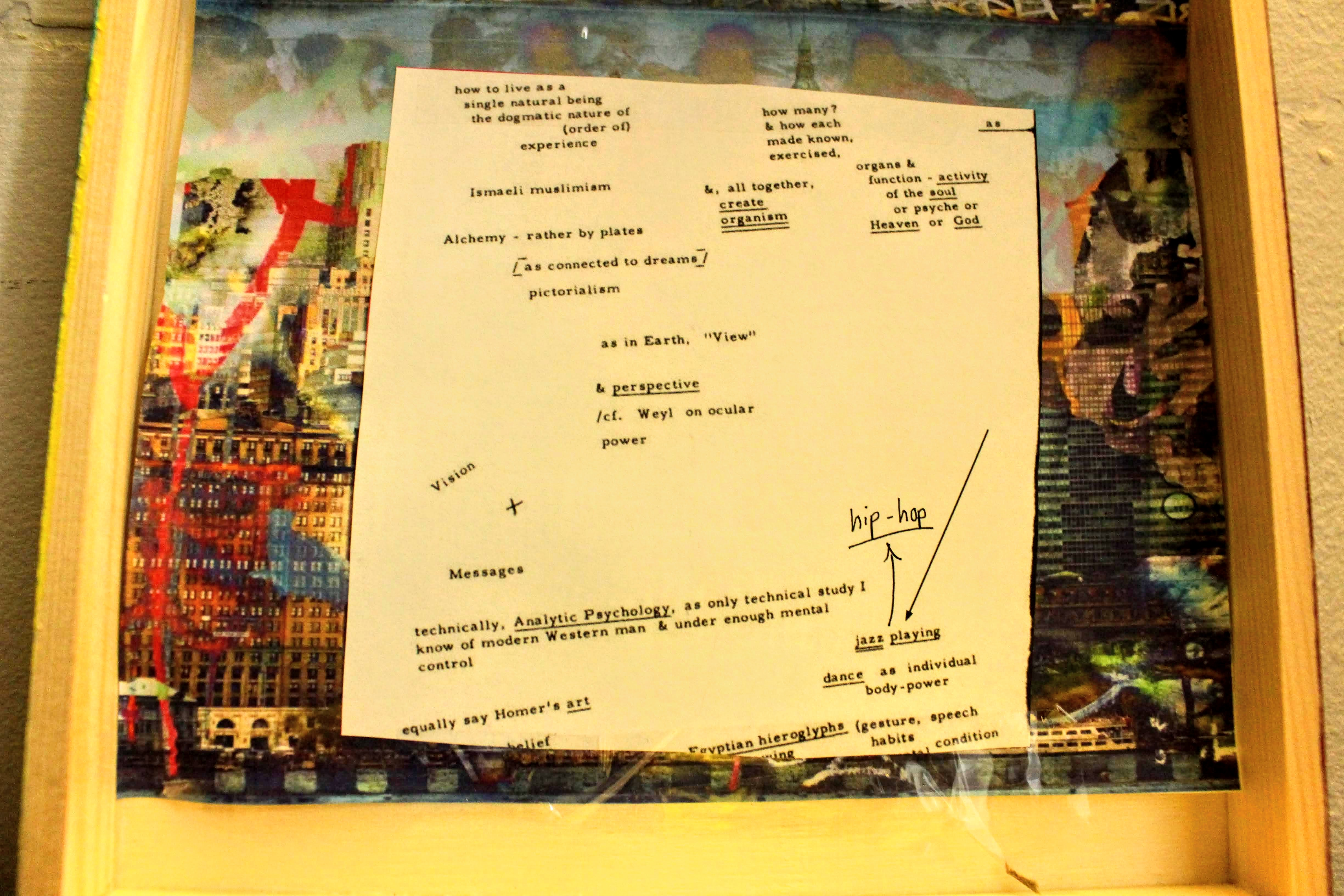 "The upper part of the inside of the box. Includes a cutout of Prospero's 'Graffiti City'. Placed on top of the cutout is the a piece of Charles Olson's ""A Plan for the Curriculum of the Soul"". Here, I drew an arrow pointing away from the term 'jazz playing' and wrote the term 'hip-hop' with a pigment liner."