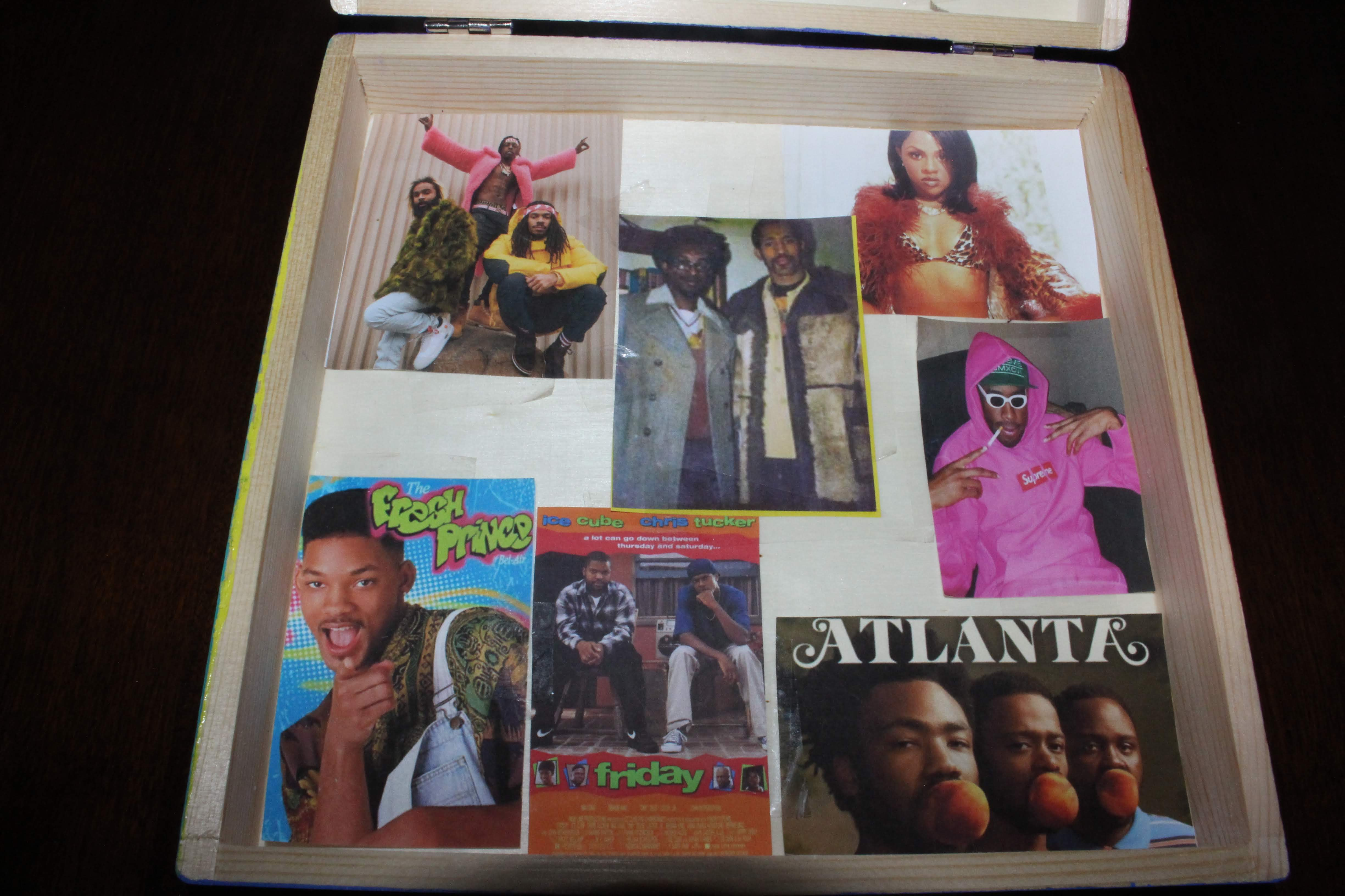 The bottom part of the inside of the box. It's a brief summary of some of my favorite musicians, tv shows, and movies that come from hip-hop culture. In the center is an image of the 'founders of hip-hop'.