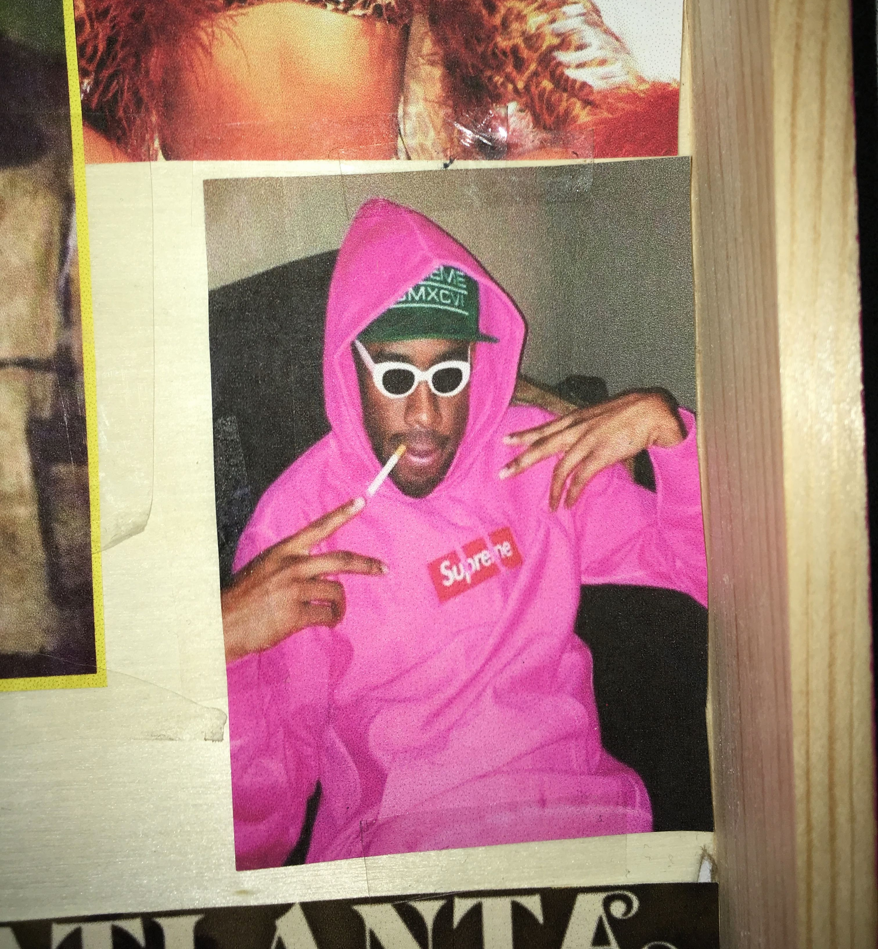 This image is a picture of Tyler, the Creator from a 2013 interview with 'Noisey'. I placed this picture in the box because he is one of the main inspirations for my art. I placed this image under the '2010s fashion' in my teaching module. However, he's a current figure in hip-hop who has branched out into multiple fields of media, such as fashion.