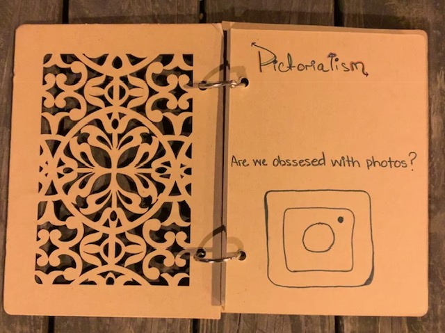 Page 1 - Carved cardboard cover page.